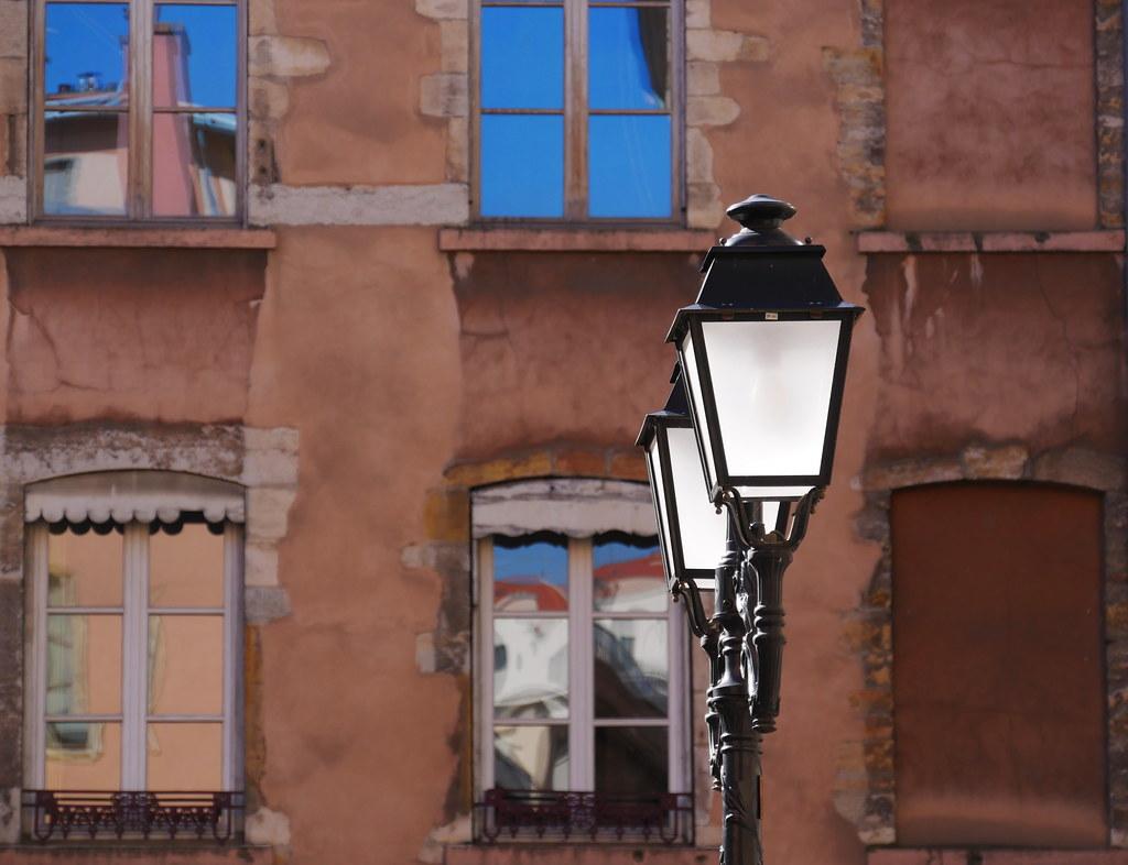 Morning sun lighting street lamps