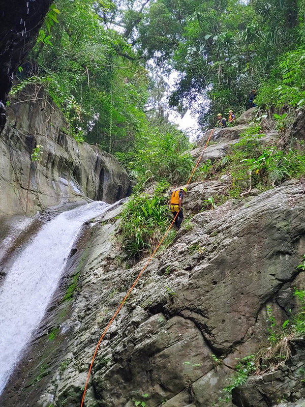 Rapelling down Nomad Falls