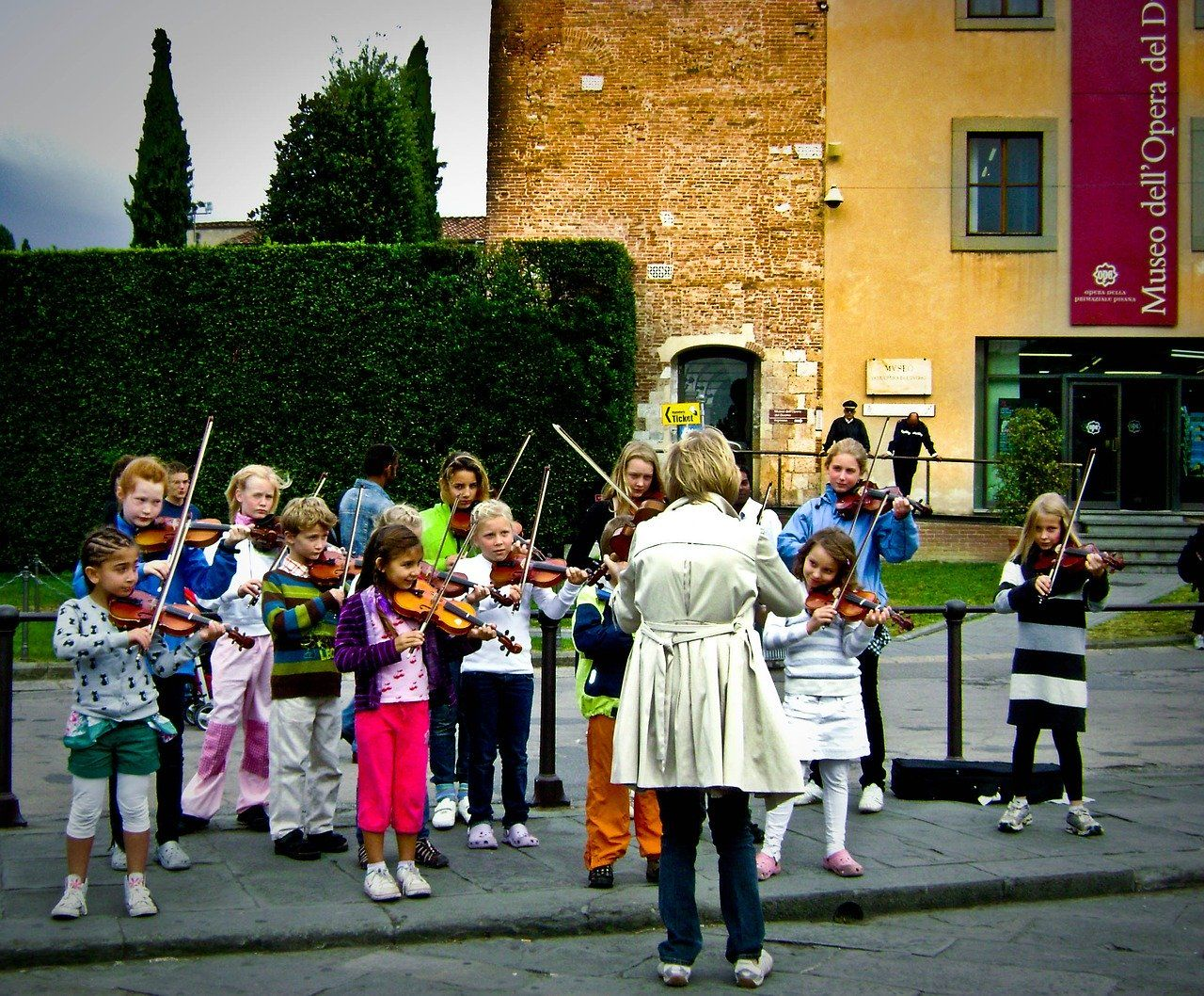 violin teacher leading a group of students