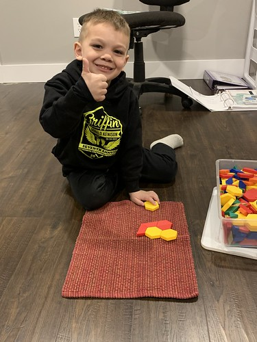 pattern blocks on his work mat
