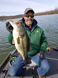 Photo of man holding a largemouth bass