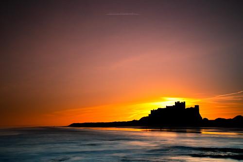 sunrise silhouette bamburgh castle bamburghcastle northumberland seascape