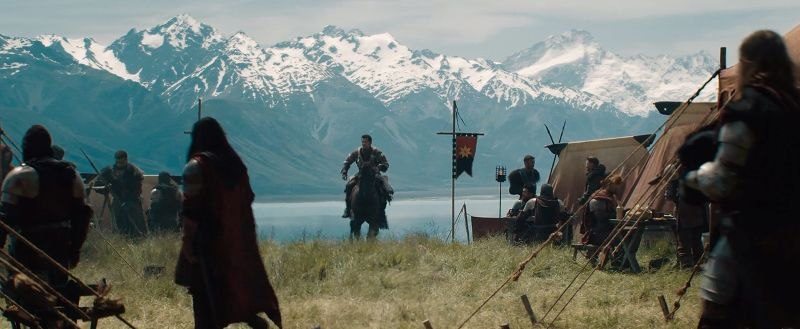 Medieval knights with New Zealand mountains and lake