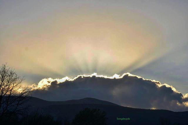 Sunrays over the clouds. Photo taken in Makarska, Croatia.The island you see is Brac
