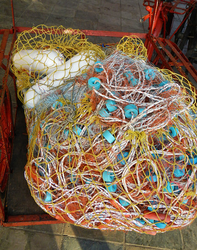 Colourful buoys and fishing nets wrapped up in a bag in Portugis, Malaysia