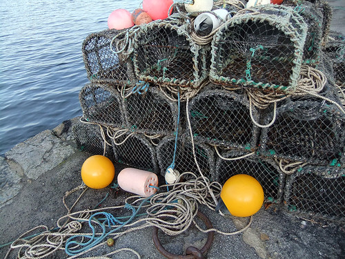 Crab traps, ropes and buoys stacked on a dock in Roundstone, Ireland