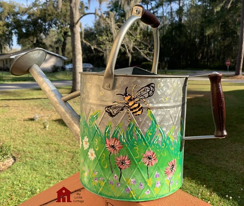 spring meadow painted watering can