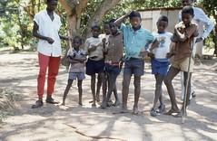 Boys with a dead snake