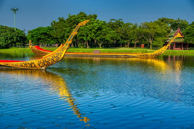 Replicas of the Royal Barges in a lake in Muang Boran (Ancient City) in Samut Phrakan near Bangkok, Thailand