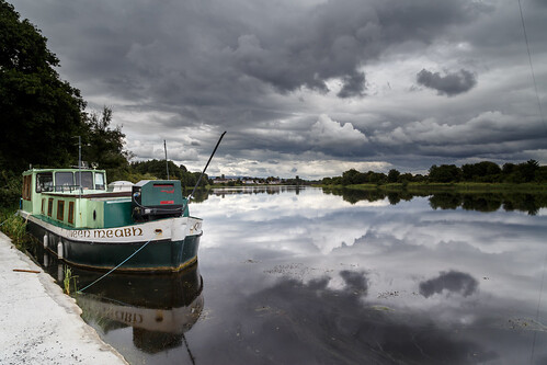 water boat river watercraft vehicle sky cloud landscape lake reflection outdoors nature storm ship harbor watertransportation outdoor transportation cloudy snow fisherman waterway driving waterfront small shannon obriensbridge clare ireland