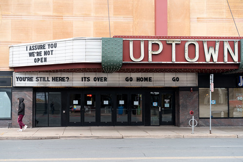 """I assure you we're not open,"" a reference to the movie Clerks and ""You're Still here? Its over. Go home. Go"" from Ferris Bueller's Day Off on the Uptown Theatre marquee in Minneapolis, Minnesota 