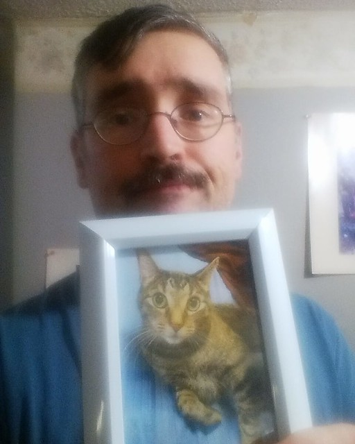 Blurry selfie, with portrait of Shakespeare #toronto #dovercourtvillage #shakespeare #caturday #catstagram #catsofinstagram #shakespeare #photo #inmemoriam