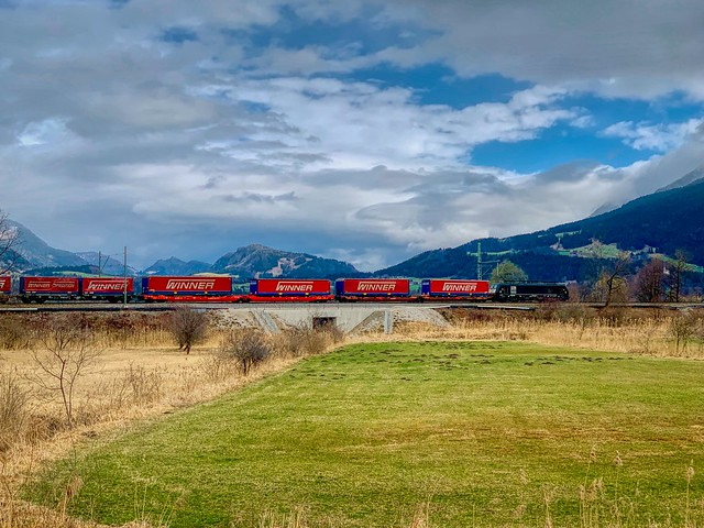 Freight train passing through Bavarian landscape between Oberaudorf and Kiefersfelden