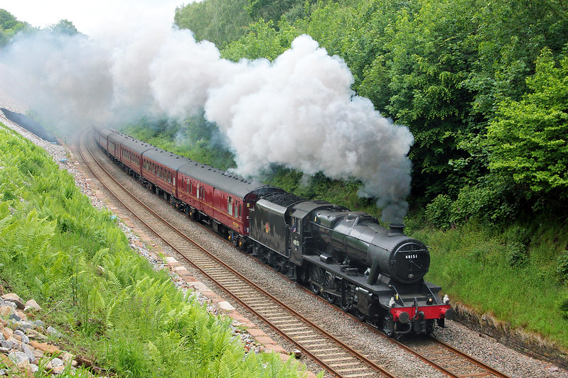 Ever since the Settle Carlisle Railway's construction, Eden Brows had been known to be a weak spot for subsidence. After many years of being subject to a temporary speed restriction, in 2014 stabilisation work was completed, which opened this angle up to the photographer, captured with 8F No.48151 leading a Cathedrals Express.  It proved to be insufficient, as a huge slippage occurred in February 2016 directly behind the train captured here and the line stayed closed as a through route for over 12 months. Since the line re-opened in 2017, lineside growth has taken over and this view is lost once again.