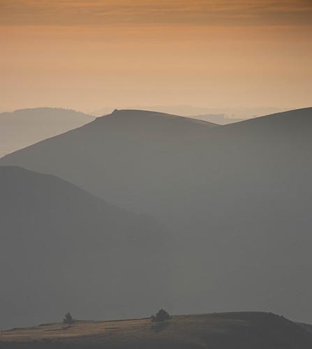 sunrisechurchstrettonlongmynd sunrise mist misty hills layers sky golden blue heather cloud view landscape isolation lonely