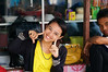 Indonesian girl smiling in a shop at a market in Glodok, the Chinese neighborhood in Jakarta - Java - Indonesia by Alex_Saurel