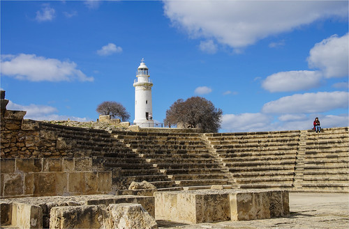 A lighthouse with a roman amphitheatre in the foreground in Paphos
