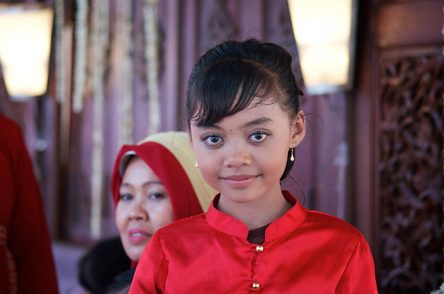 Little Indonesian girl in traditional red dress at a Traditional Indonesian Wedding in Jakarta - Java - Indonesia