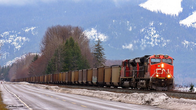 Coal drag rumbles west down the Skeena River Valley behind CN 3016 & 8859, on CN's Skeena Subdivision a few miles east of Exstew, BC - 28 March 2020 [© WCK-JST]