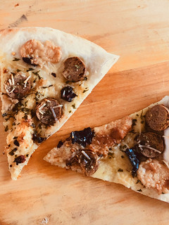 Thin Crust Pizza with Black Garlic Italian Sausage and Smoked Mozzarella