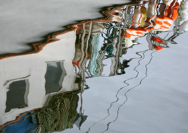water reflection of boat in harbor