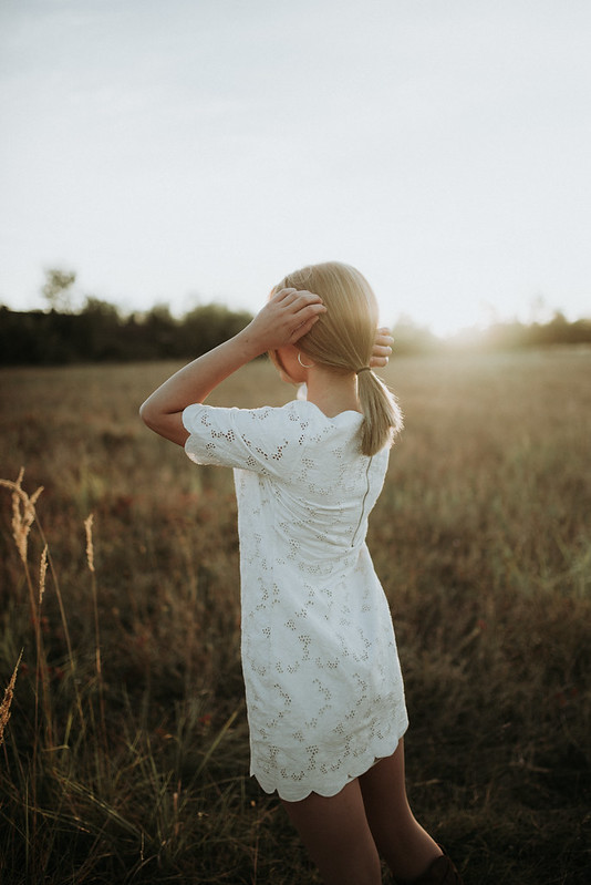 Girl on field at sunset.