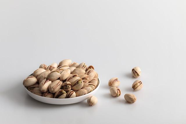 Pistachio nuts in a mini dish