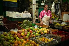 serious merchant in the mercado