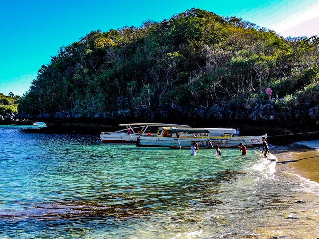 The children enjoying the tropical beach.