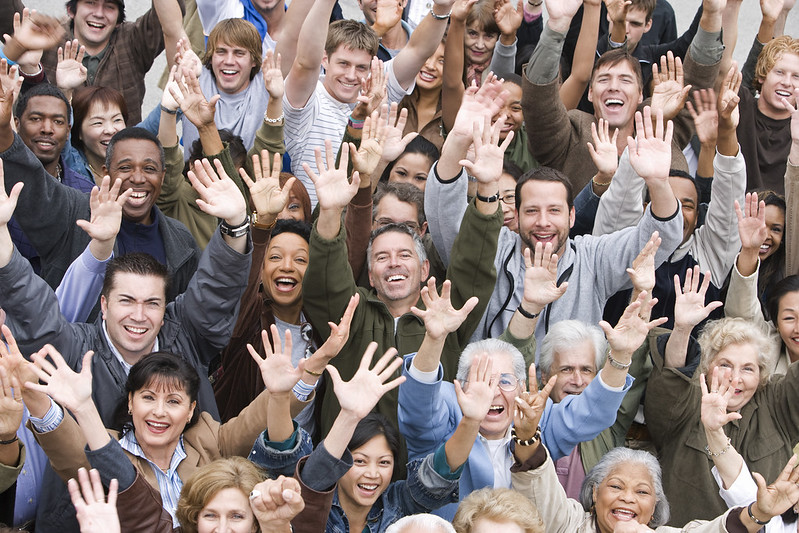 group of people with raised hands