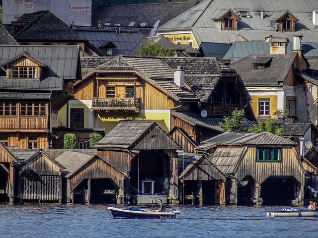 The heritage wooden houses of the Hallstatt village in front of the lake.