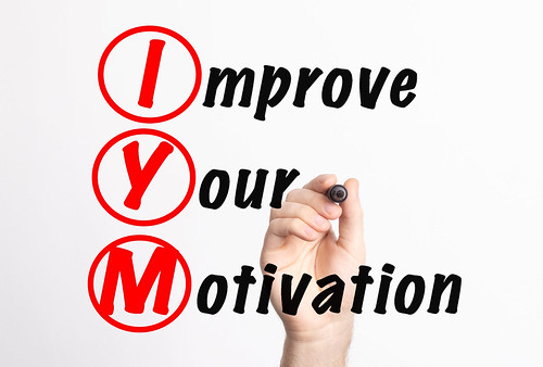 IYM - Improve Your Motivation acronym with marker, concept background | by focusonmore.com