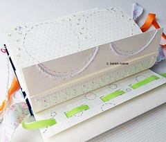 embroidering a gridded notebook