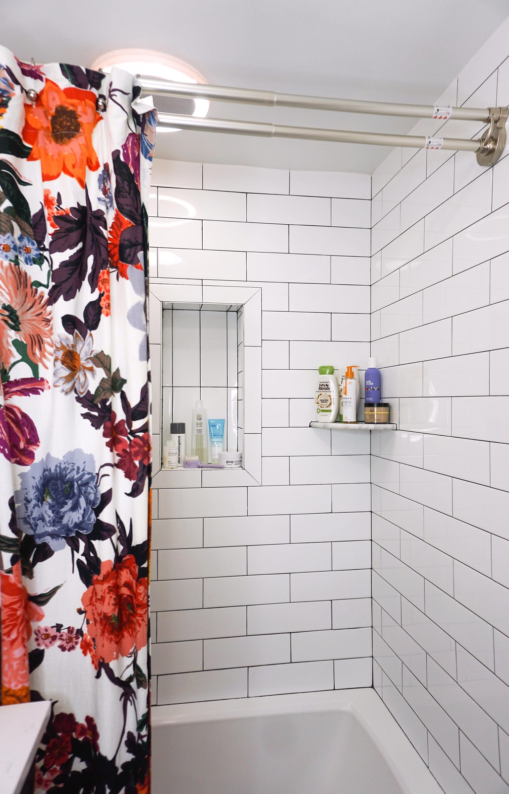 Floor to Ceiling White Subway Tile Black Grout | 5 Practical Tips for Designing a Small Bathroom | Eclectic Boho Colorful Small Bathroom Inspiration