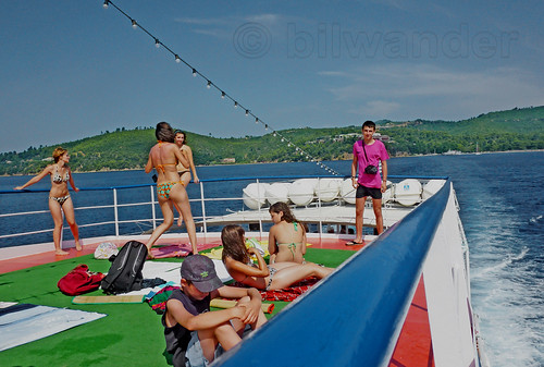 Greece. Thessaly, Aegean Sea, North Sporades, Skiathos island,  fun on the boat deck off Koukounaries beach