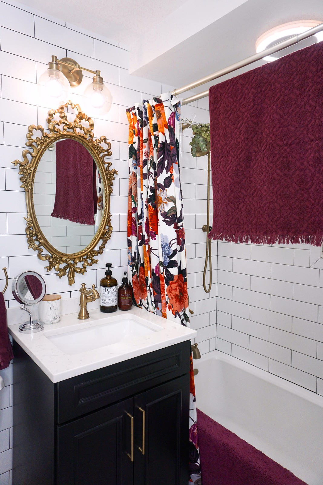 Eclectic Boho Colorful Small Bathroom | Gold Antique Mirror and Fixtures | Black Bathroom Vanity
