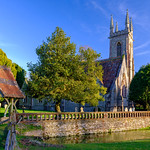 Evening light on St Nicholas' church and Chawton House, in the South Downs National Park, UK