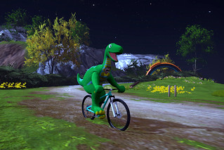 Halloween dinosaur on a mountain bike