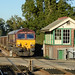 66075 Eccles Road 30/09/15 - Sporting original EWS maroon and gold livery, 66075 sprints through Eccles Road station on 30th September 2015. The station signal box stands empty after removal of the semaphore signalling years before.