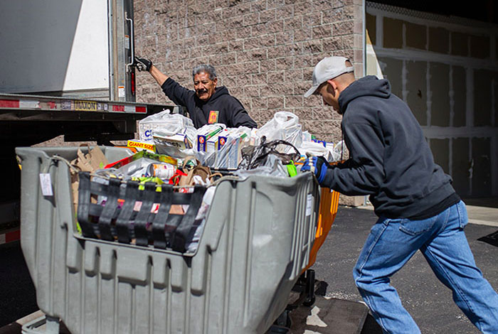 employees loading food into the truck