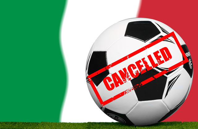 Soccer football ball with flag of Italy and Cancelled stamp