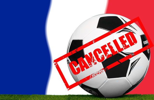 Soccer football ball with flag of France and Cancelled stamp