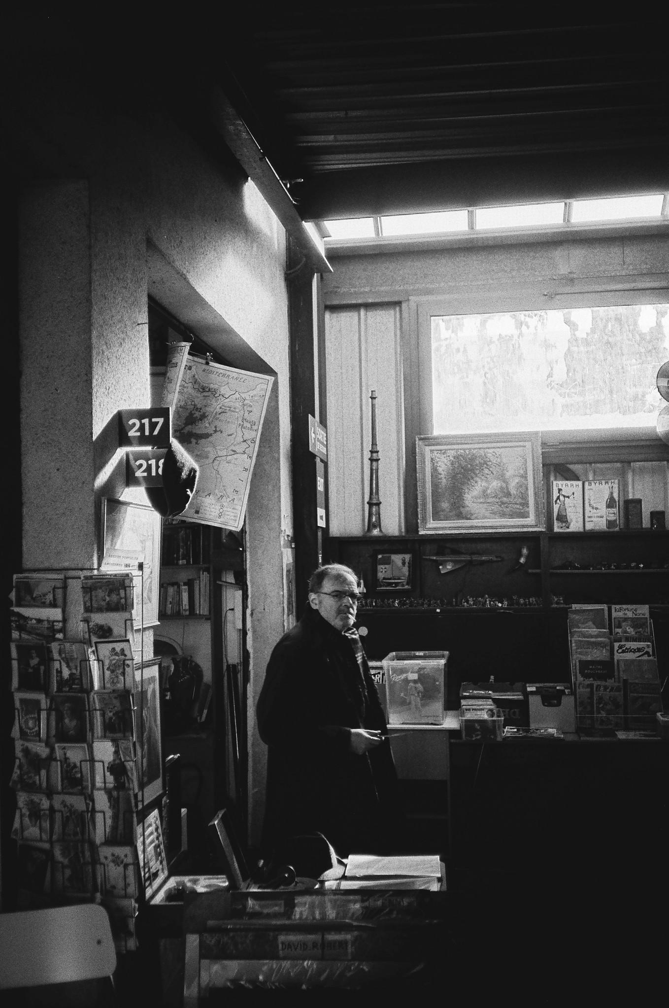 Man Smoking in Flea Market