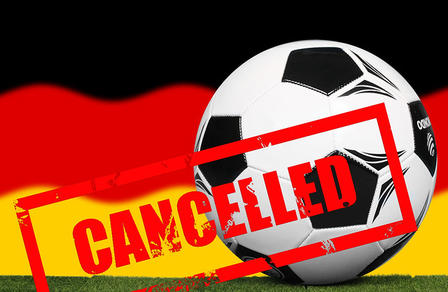 Soccer football ball with flag of Germany and Cancelled stamp