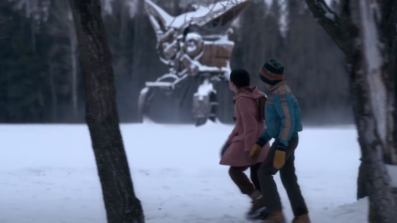 The kids walking in the snow with robot