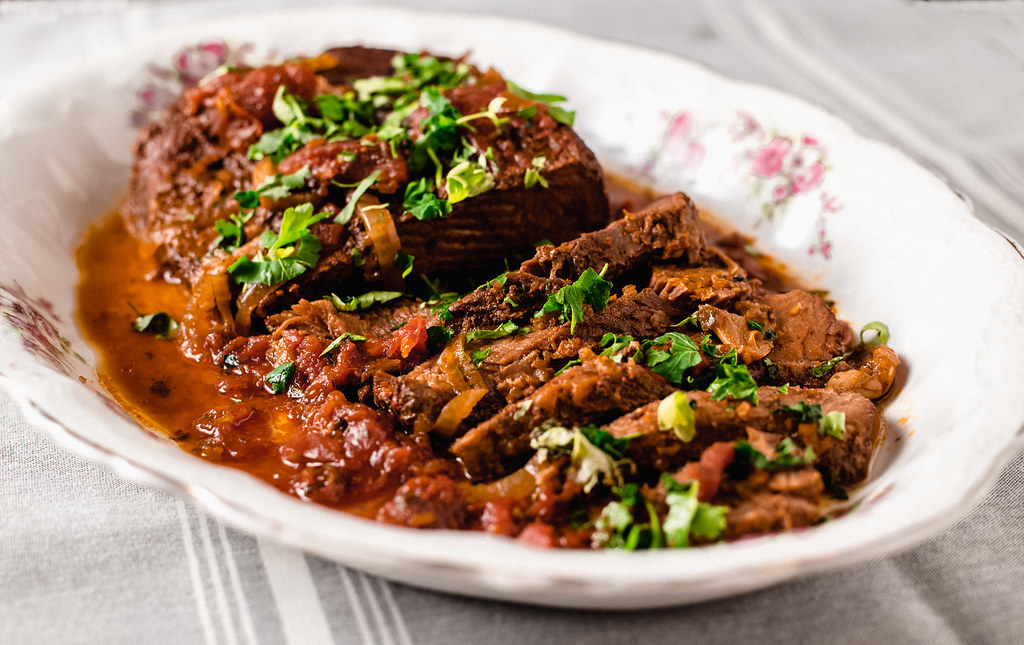 Inspired by the Cuban dish, ropa vieja, this recipe for slow cooker Cuban brisket is seasoned with bold flavors of sazon spice and slow cooked with fresh sofrito and poblano peppers.