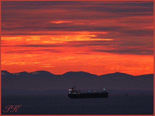 transportshipinsunsethour sunset sunsetskies sunsets sunsetclouds sunsetoutlines burrardinlet westvancouverbc water waterscenes waterreflections sky skies ships shipsandvessels boats allboats mountains vancouverisland