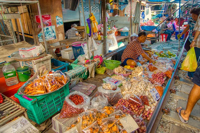 Mae Klong railway market beside an active track in Samut Songkhram province in Thailand