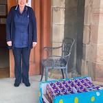 Pamela Morrison (Senior Carer) receives a donation at Alexander Scott's Hospital