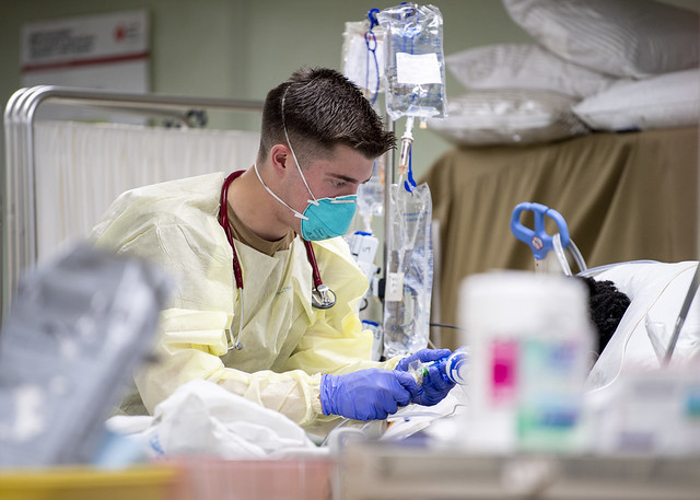 LOS ANGELES (April 4, 2020) Hospital Corpsman 2nd Class Trevor Aguiar, from Boise, Idaho, treats a patient aboard the hospital ship USNS Mercy (T-AH 19) April 4. Mercy deployed in support of the nation's COVID-19 response efforts, and will serve as a referral hospital for non-COVID-19 patients currently admitted to shore-based hospitals. This allows shore base hospitals to focus their efforts on COVID-19 cases. One of the Department of Defense's missions is Defense Support of Civil Authorities. DoD is supporting the Federal Emergency Management Agency, the lead federal agency, as well as state, local and public health authorities in helping protect the health and safety of the American people. (U.S. Navy photo by Mass Communication Specialist 2nd Class Ryan M. Breeden)